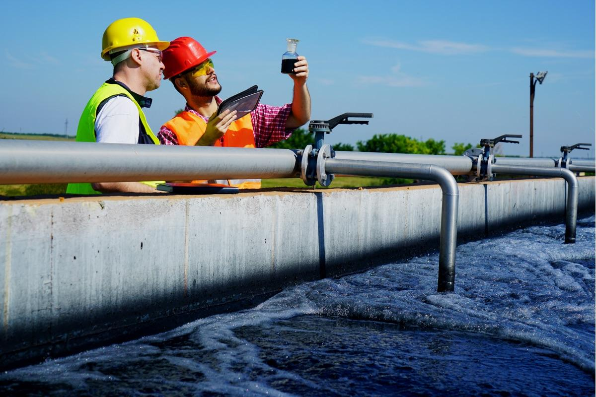 Engineers control water quality in a wastewater treatment plant